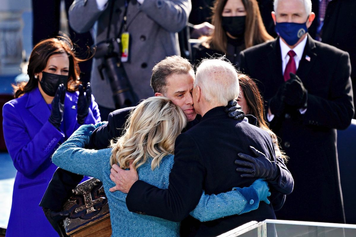 President Joe Biden(R) is comforted by his son Hunter Biden and First Lady Jill Biden after being sworn in during the presidential inauguration in Washington, DC on the West Front of the US Capitol on January 20, 2021 in Washington, DC
