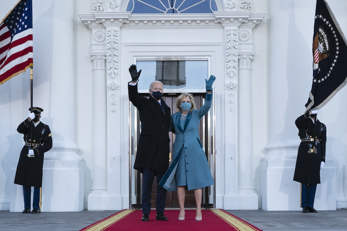 President Joe Biden and first lady Dr. Jill Biden wave as they arrive at the North Portico of the White House, on January 20, 2021, in Washington, DC. United States.