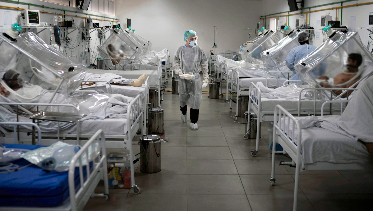 Medical staff work in the Intensive Care Unit (ICU) for COVID-19 multiple patients inside a special hospital in Bergamo, on November 11, 2020.