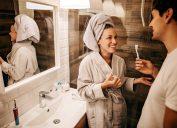 Couple brushing teeth in bathroom
