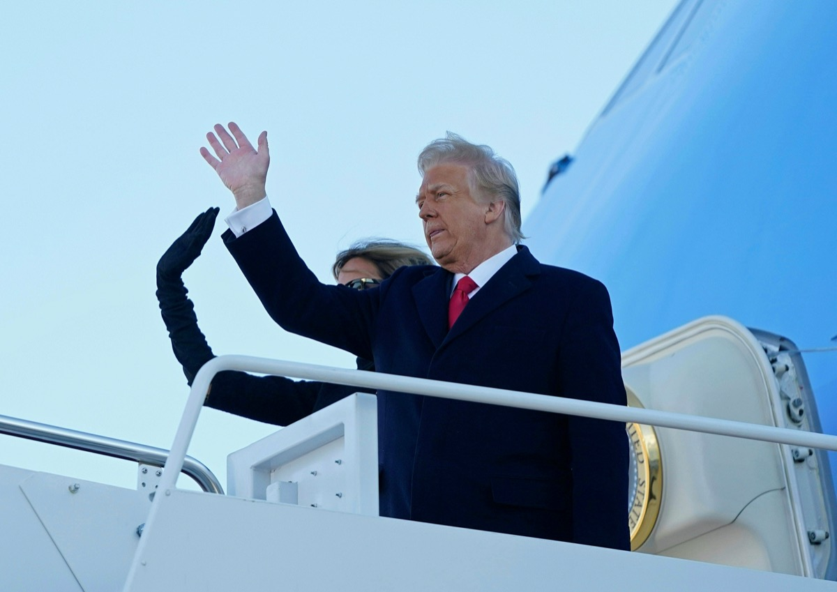 donald and melania trump wave from the steps of air force one