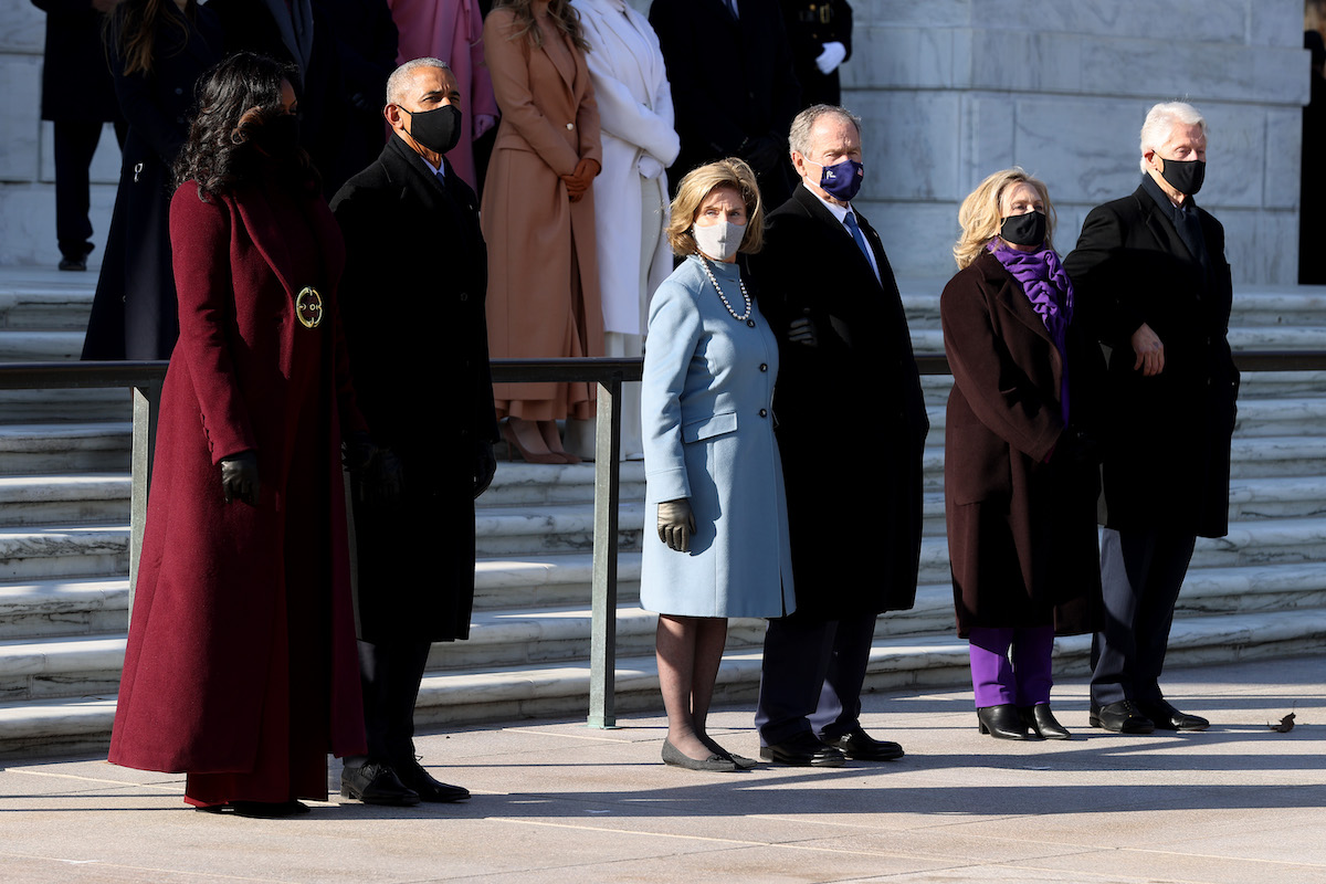 Former U.S. President Barack Obama, Michelle Obama, and former U.S. President George W. Bush and Laura Bush, and former U.S. President Bill Clinton and former Secretary of State Hillary Clinton attend a wreath-laying ceremony at the Tomb of the Unknown Soldier after the President Joe Biden's Presidential Inauguration at the U.S. Capitol January 20, 2021 at Arlington National Cemetery in Arlington, Virginia.