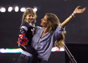 Gisele Bundchen celebrates with daughter Vivian Brady after the New England Patriots defeated the Atlanta Falcons during Super Bowl 51 at NRG Stadium on February 5, 2017 in Houston, Texas