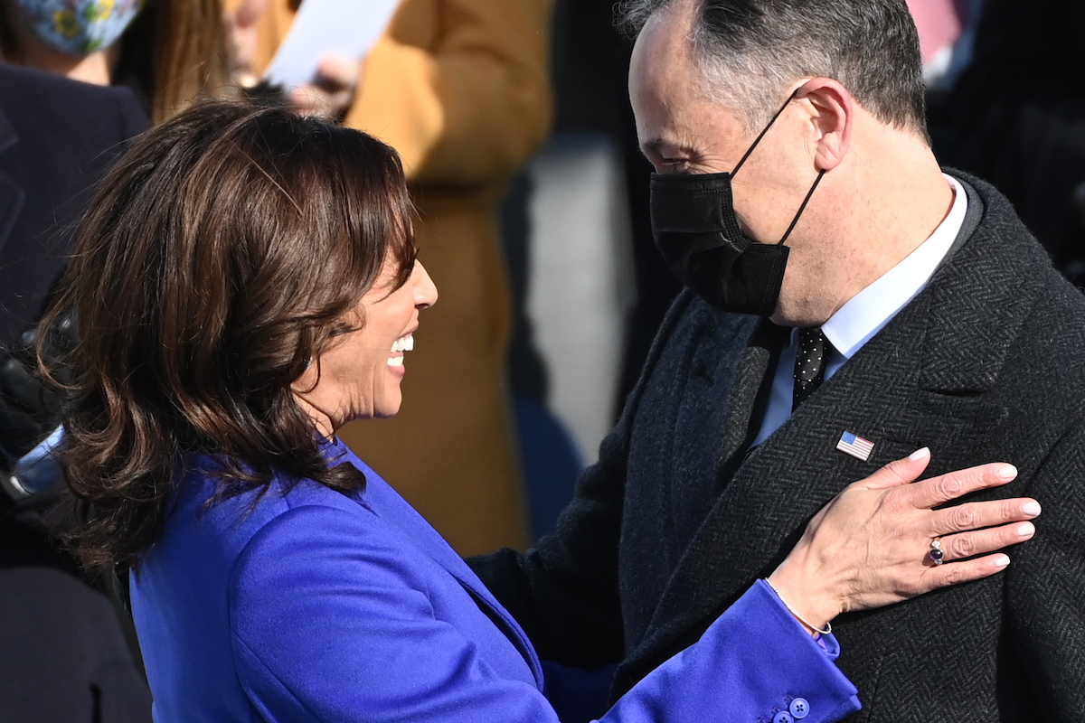 Kamala Harris is embraced by her husband Doug Emhoff after being sworn in as the 46th US Vice President by Supreme Court Justice Sonia Sotomayor on January 20, 2021, at the US Capitol in Washington, DC.