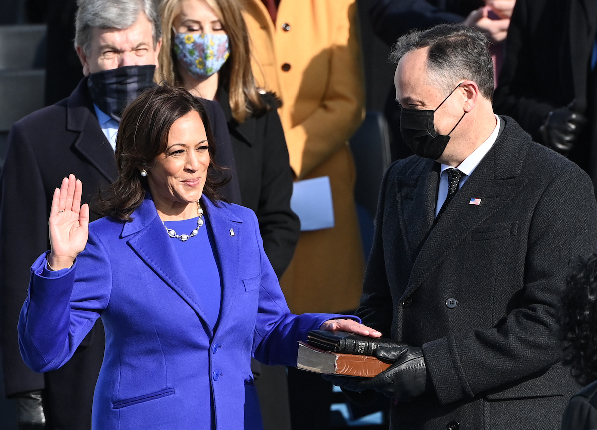 Kamala Harris, flanked by her husband Doug Emhoff, is sworn in as the 46th US Vice President by Supreme Court Justice Sonia Sotomayor on January 20, 2021, at the US Capitol in Washington, DC.