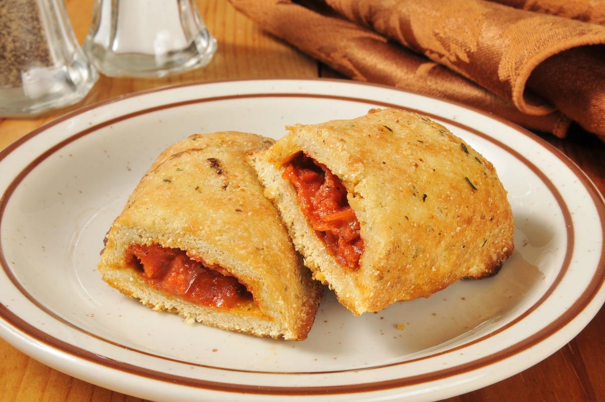 Hot pizza rolls or pockets broken open on a plate