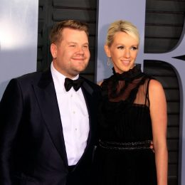 james corden and his wife julia carey on the red carpet in a black suit and dress, respectively