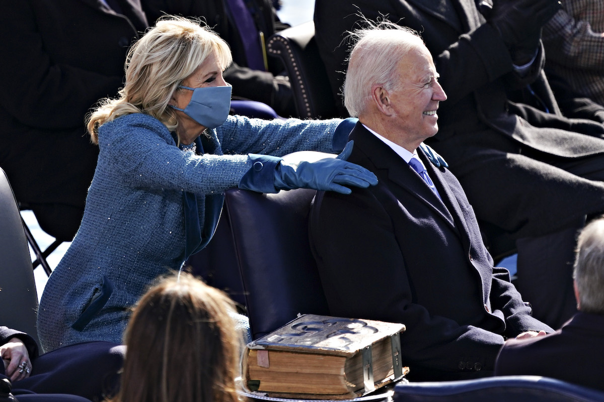 Incoming US First Lady Jill Biden (L) places her hands on US President-elect Joe Biden during his inauguration as US President, on the West Front of the US Capitol in Washington, DC on January 20, 2021.