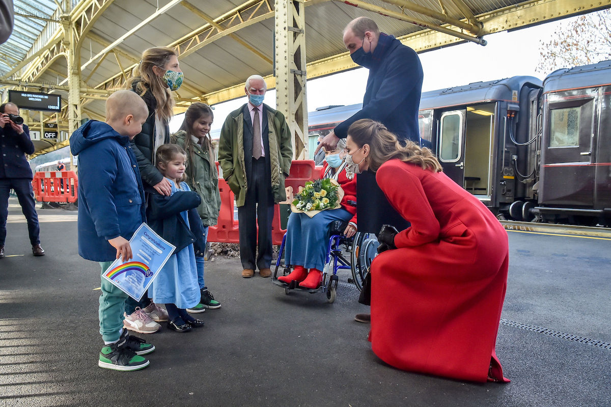 Prince William, Duke of Cambridge and Catherine, Duchess of Cambridge arrive at Bath Spa train station and take time to meet and chat with Jasmine Warner, 5, centre, who's brother Otto, 8, left, has today come out of cancer treatment and was by chance hoping to meet the royal couple with his family, including sister Poppy, 10, right, and mum Georgie, ahead of a visit of the Duke and Duchess to a care home in the city to pay tribute to the efforts of care home staff throughout the COVID-19 pandemic on December 08, 2020 in Bath, England. The Duke and Duchess are undertaking a short tour of the UK ahead of the Christmas holidays to pay tribute to the inspiring work of individuals, organizations and initiatives across the country that have gone above and beyond to support their local communities this year.
