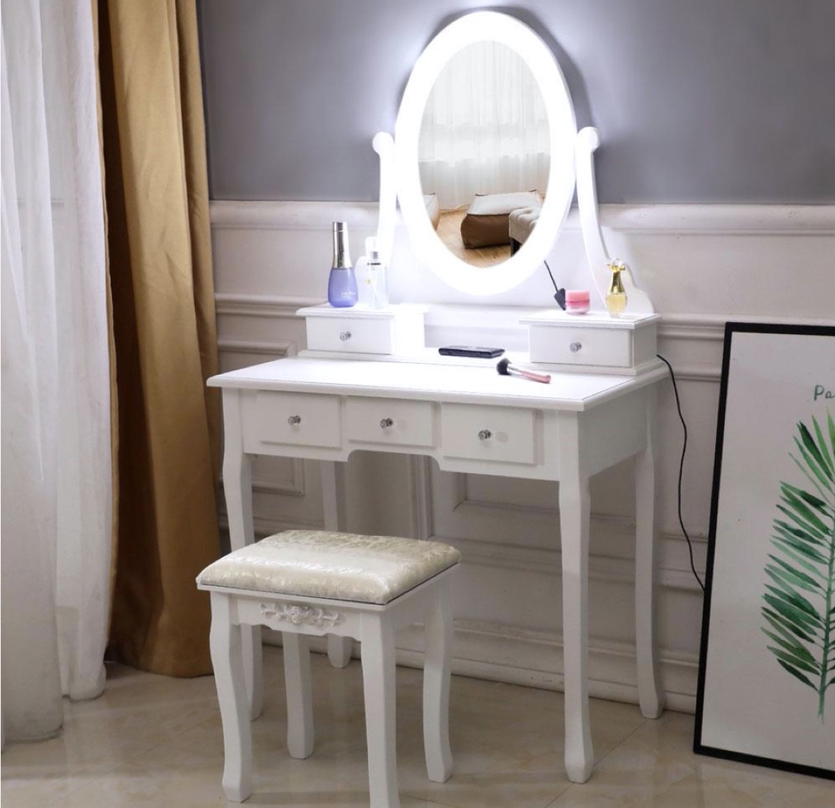 white vanity with oval mirror and LED lights