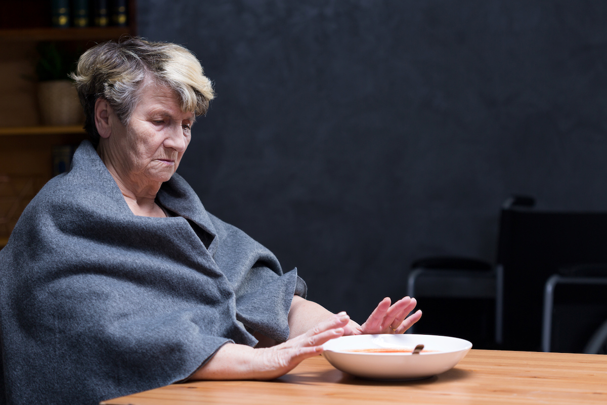elderly woman refusing to eat meal