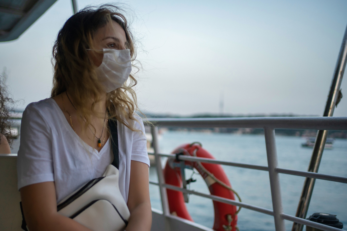 woman with protective face mask on the ferry