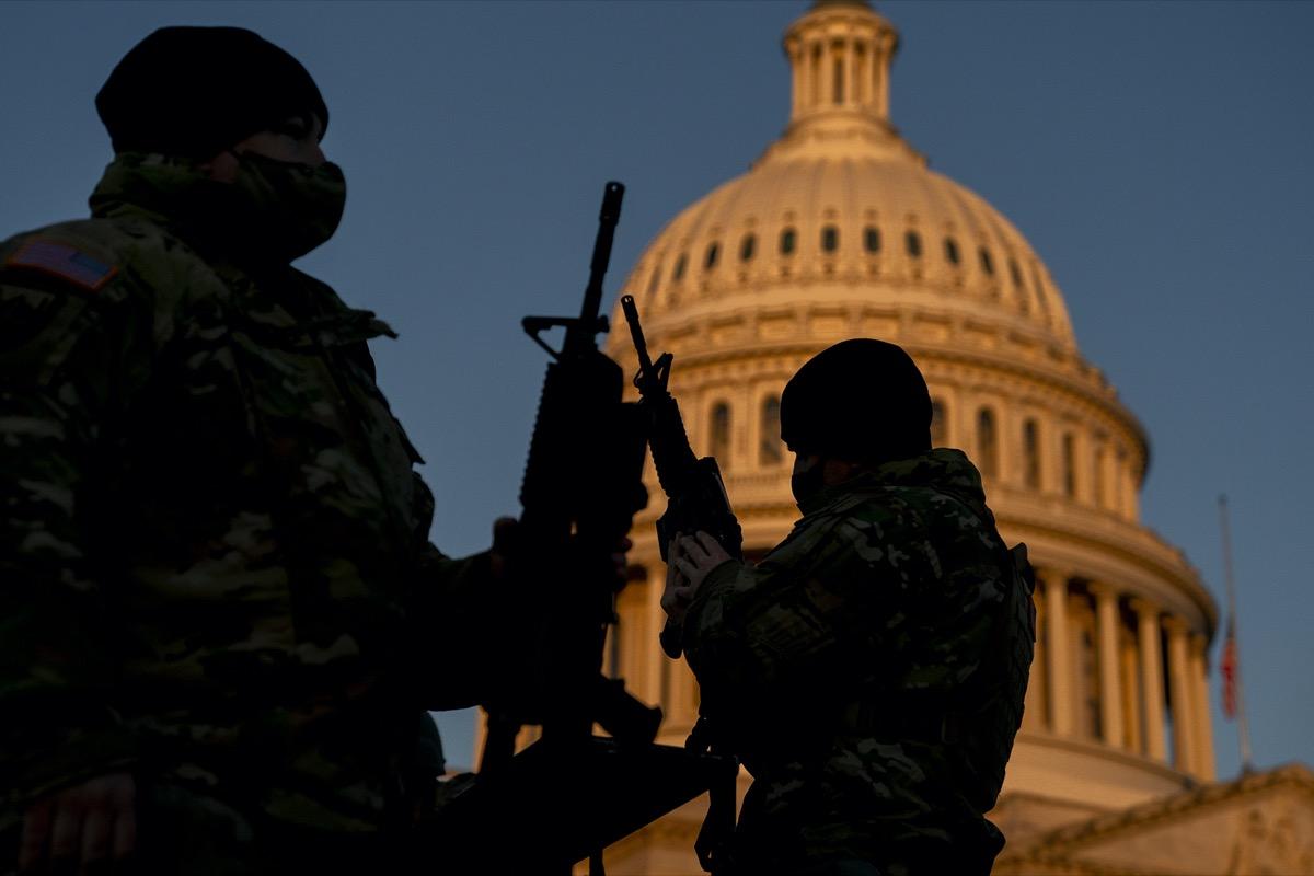 national guard members receiving long guns outside capitol building