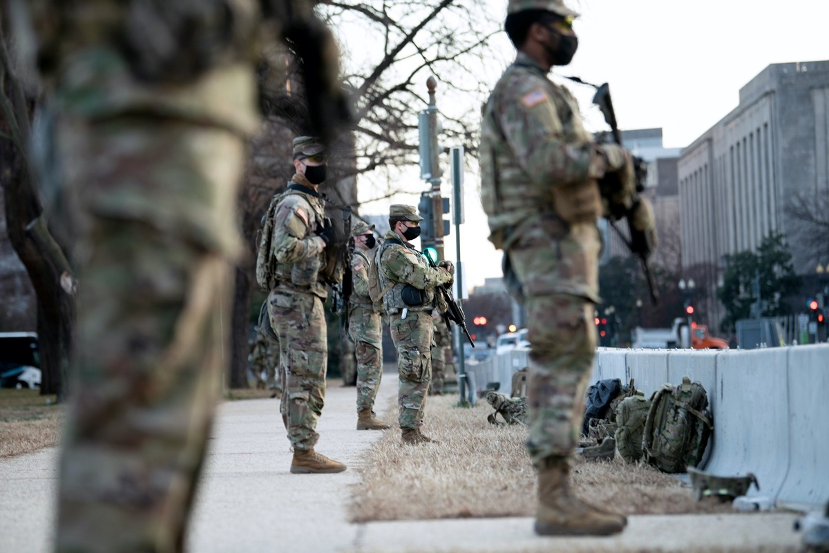 national guard members standing guard on capitol hill