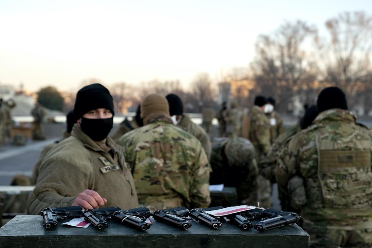 national guard members receiving handguns outdoors in d.c.
