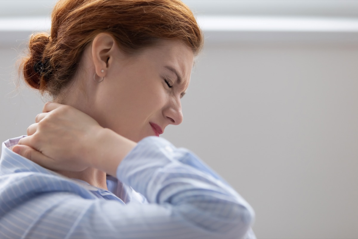 Woman with neck pain from COVID