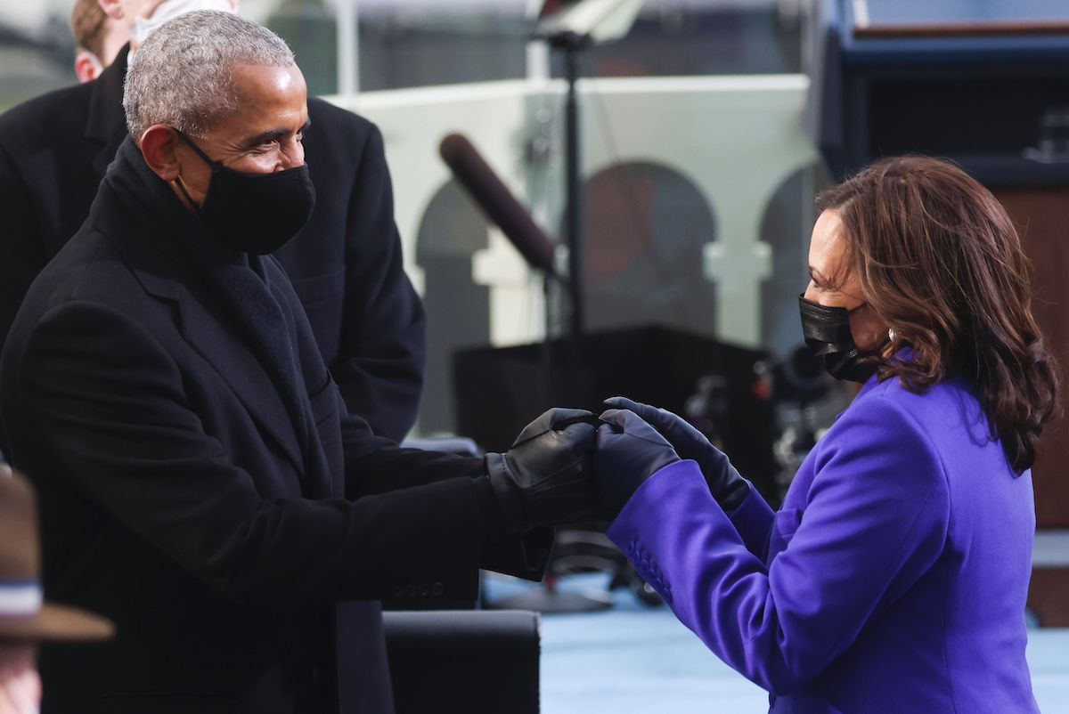 Former US President Barack Obama (L) bumps fists with US Vice President-elect Kamala Harris as they arrive for the inauguration of Joe Biden as the 46th US President, on the West Front of the US Capitol in Washington, DC on January 20, 2021