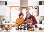 older couple preparing food together