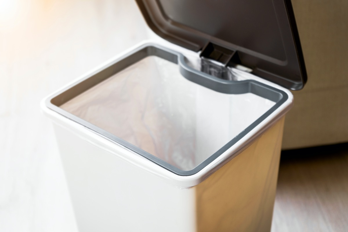 black and white trash can with open lid