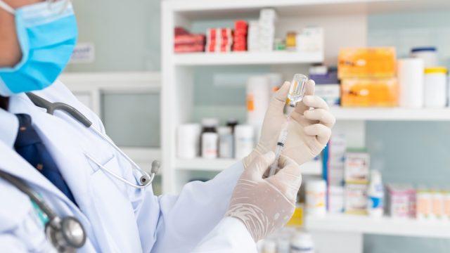 Pharmacy giving COVID vaccine