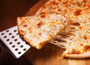 cheese pizza on a metal spatula