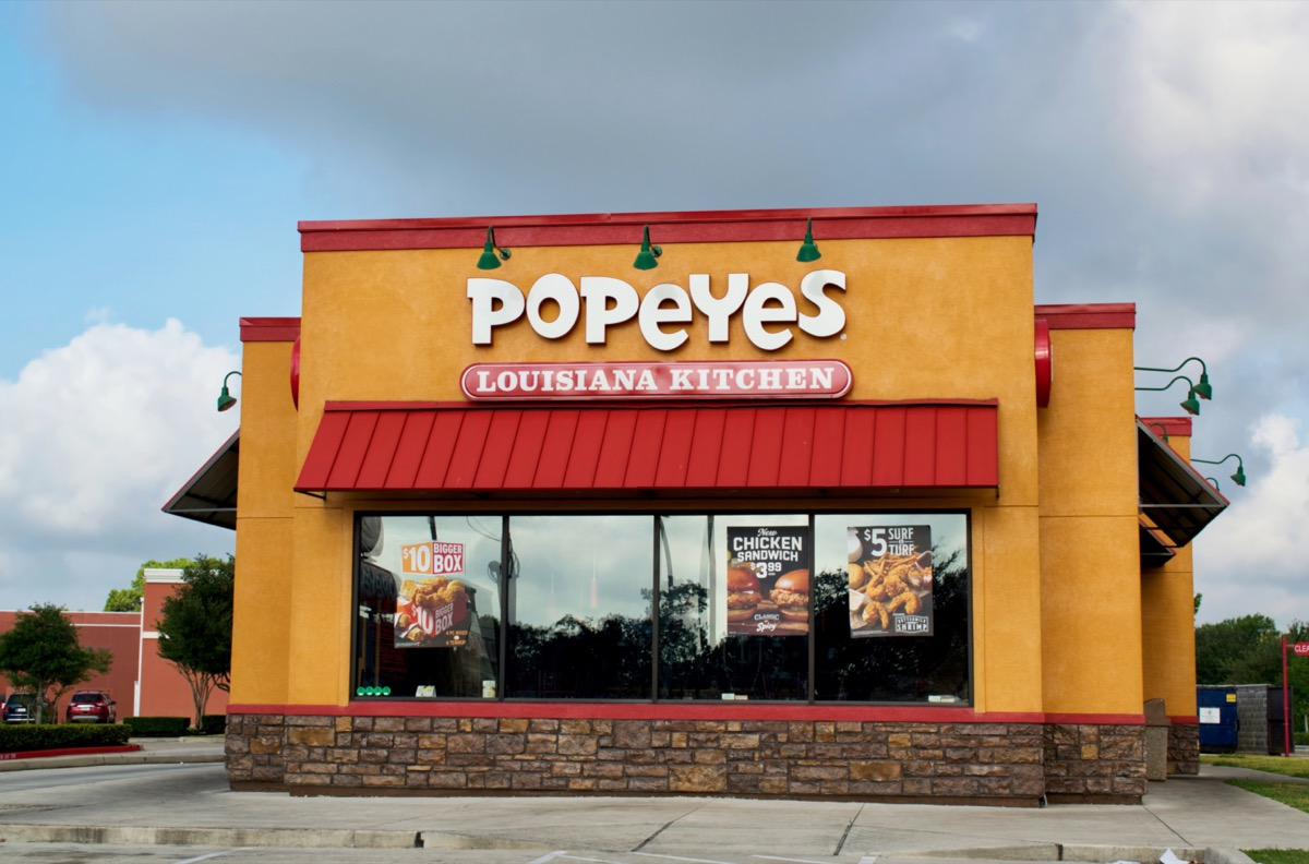 the exterior of a Popeyes restaurant in Houston, Texas
