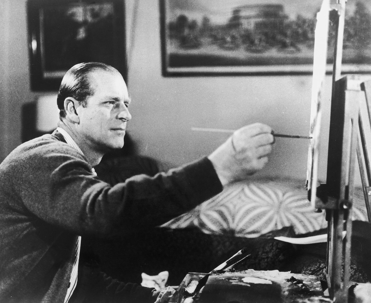 The Duke of Edinburgh at work on one of his hobbies, painting, 19th June 1969. A scene from the television documentary 'Royal Family'.
