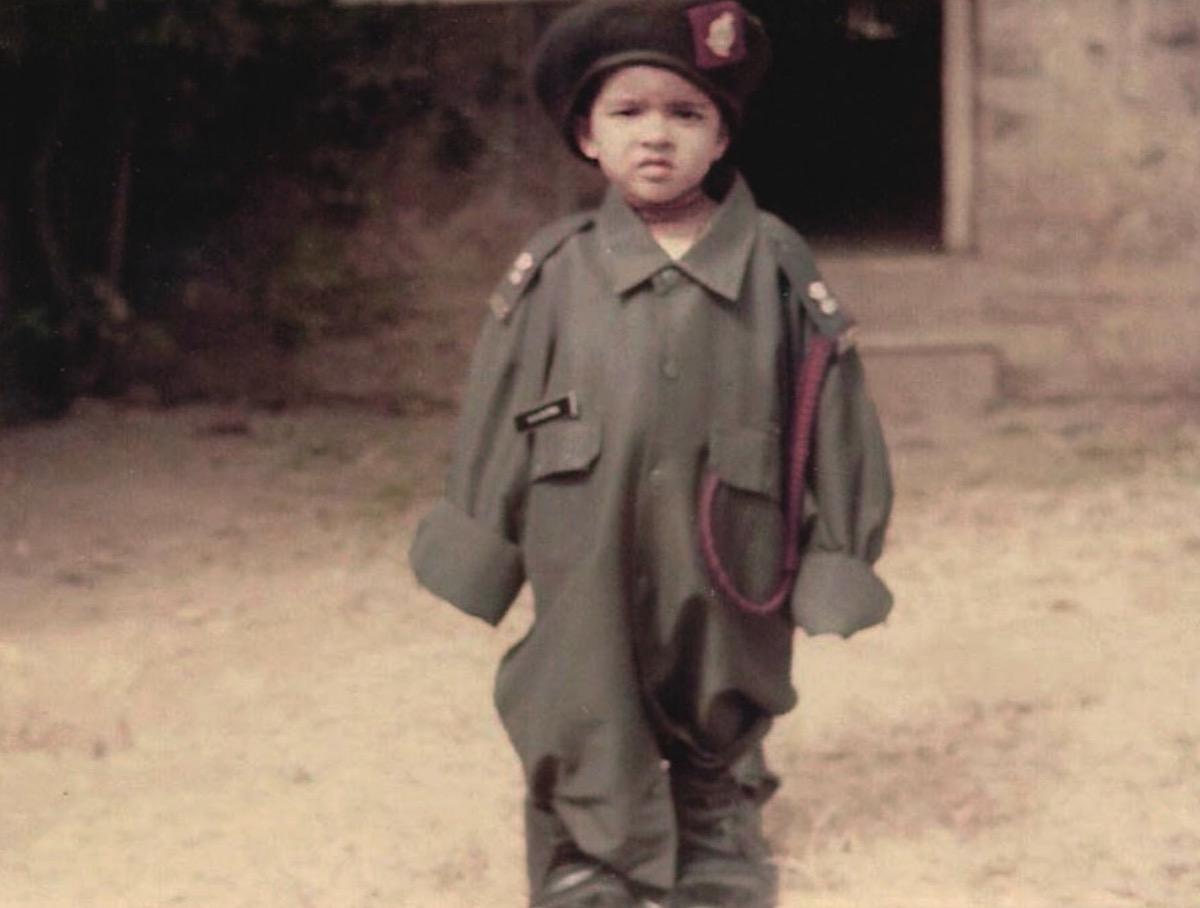 priyanka chopra as a baby wearing an army uniform and beret