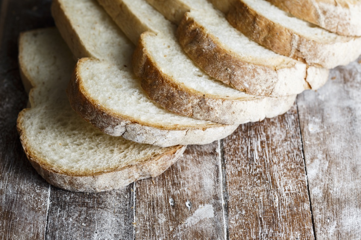 sliced white bread on wooden table