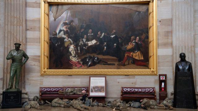 national guard members sleep under painting in us capitol rotunda