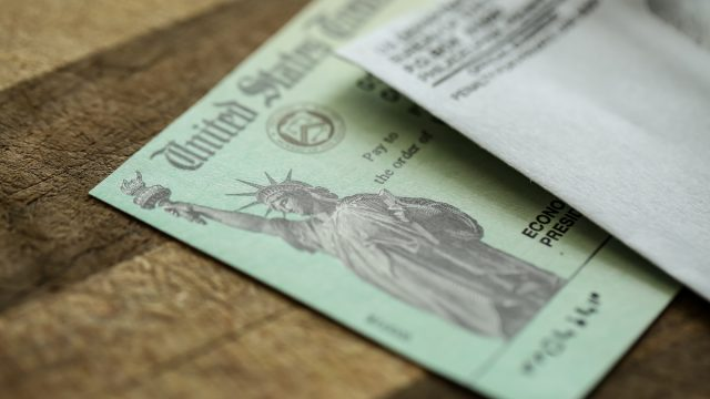 Extreme close-up of Federal coronavirus stimulus check provided to Americans from the United States Treasury in 2020, showing the statue of liberty.