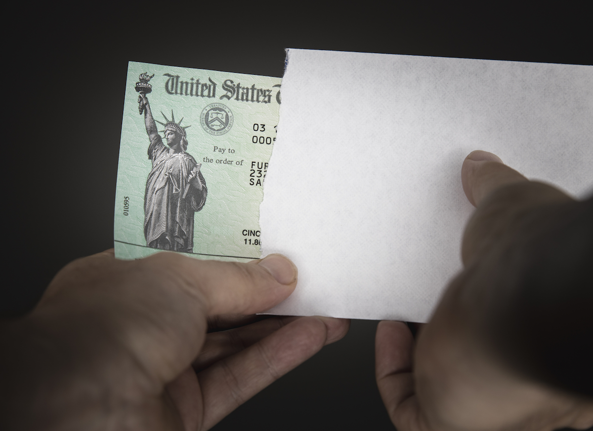 United States Treasury check with envelope arriving in mail.
