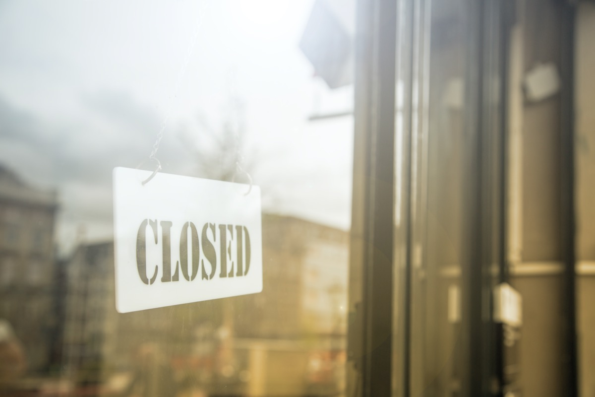 glass door with store closed sign