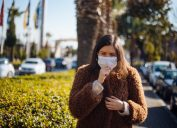 Young woman wearing mask to protect herself from virus