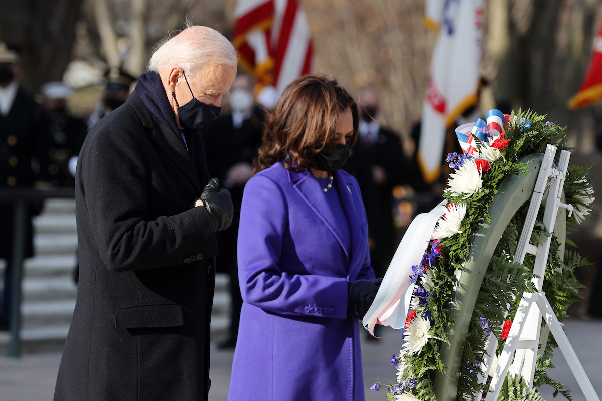 President Joe Biden and Vice President Kamala Harris attend a wreath-laying ceremony at Arlington National Cemetery's Tomb of the Unknown Soldier after Presidential Inauguration ceremony at the U.S. Capitol January 20, 2021 in Arlington, Virginia