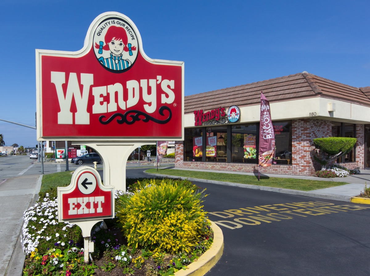 the exterior and sign of a Wendy's restaurant in Seaside, California
