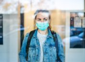 Worried woman wearing a protective medical mask White House vaccine supply discussion