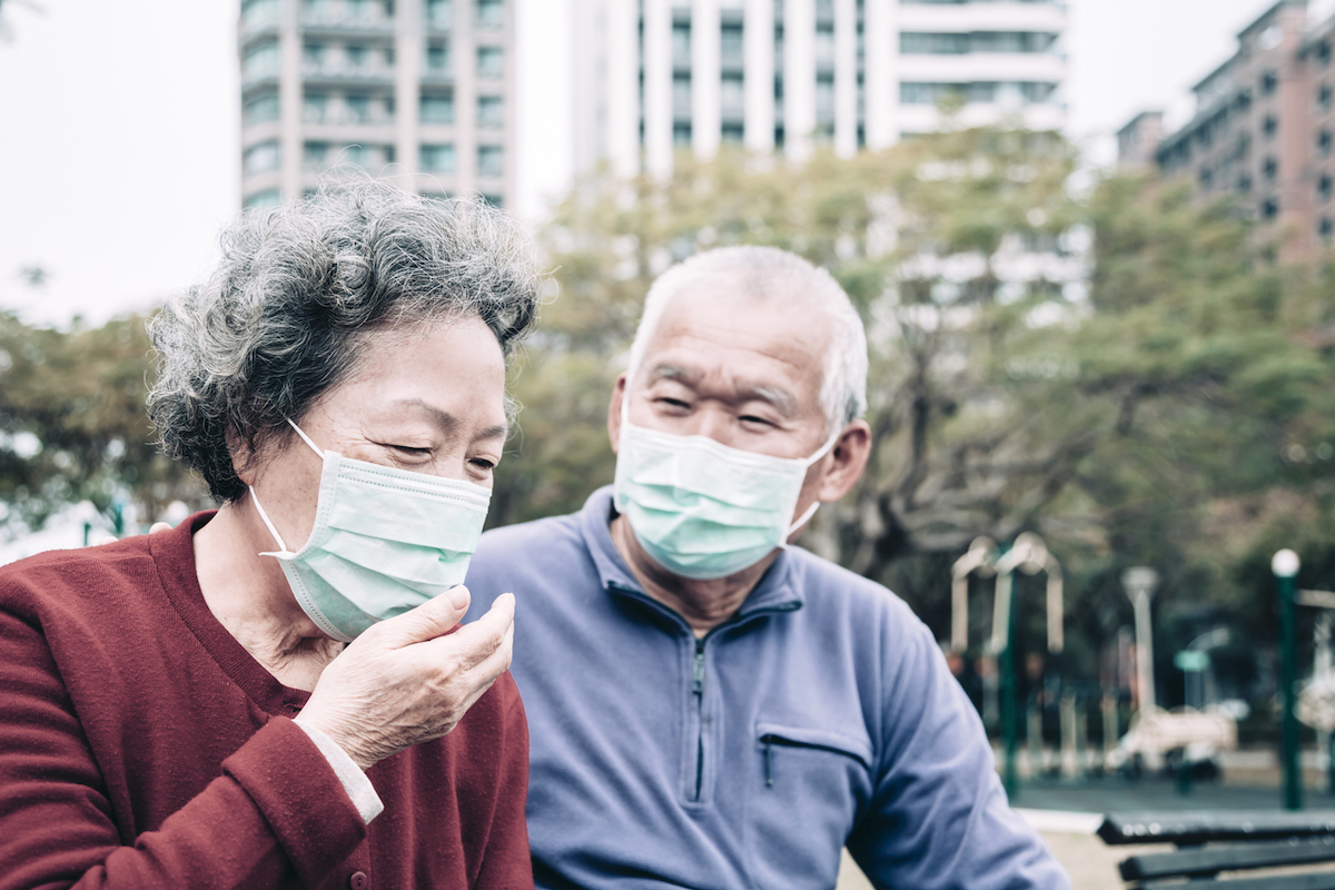 sick senior couple wear with protective face mask