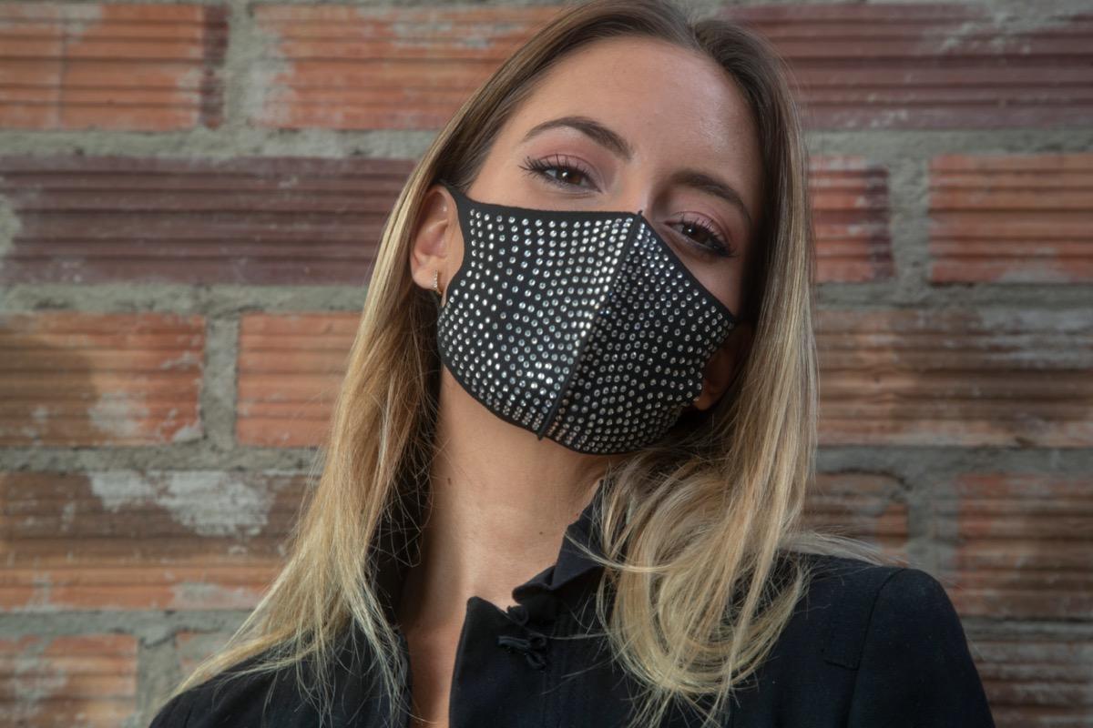 blonde woman wearing rhinestone face mask