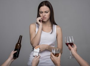Woman tempted by bad habits
