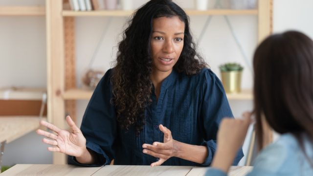 Businesswoman explaining new responsibilities to female applicant.