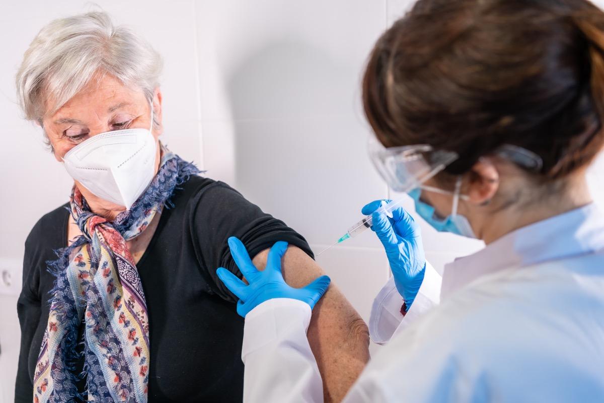 Woman getting COVID antibody treatment