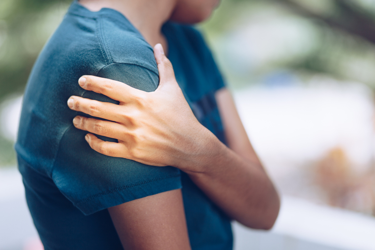 Woman with pain in upper arm