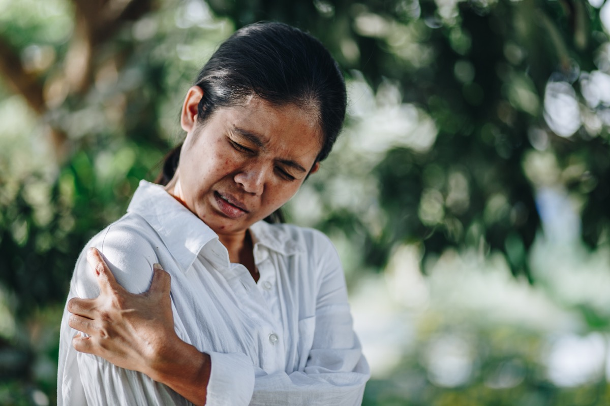 Woman with pain in shoulder and upper arm, Ache in human body , office syndrome , health care concept