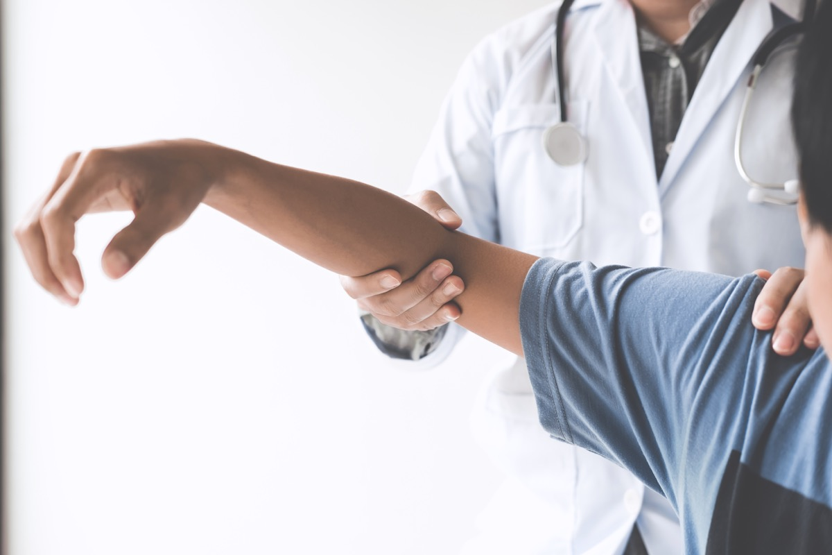 Doctor checking patient with elbow to determine the cause of illness.