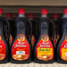 Bottles of Aunt Jemima maple syrup sitting on a store shelf