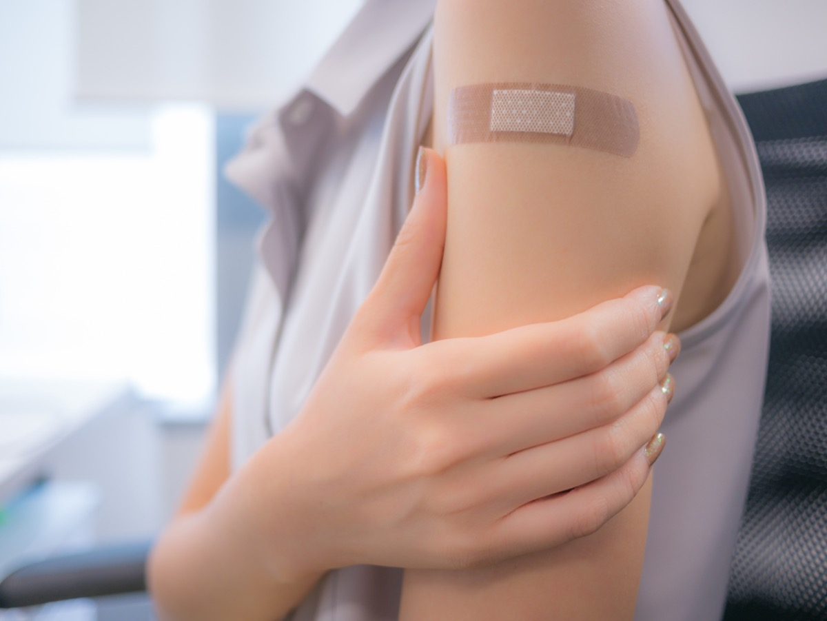 adhesive bandage on a person's arm