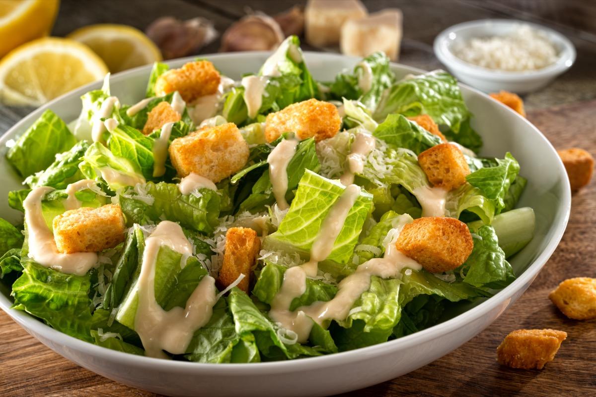 caesar salad in white bowl