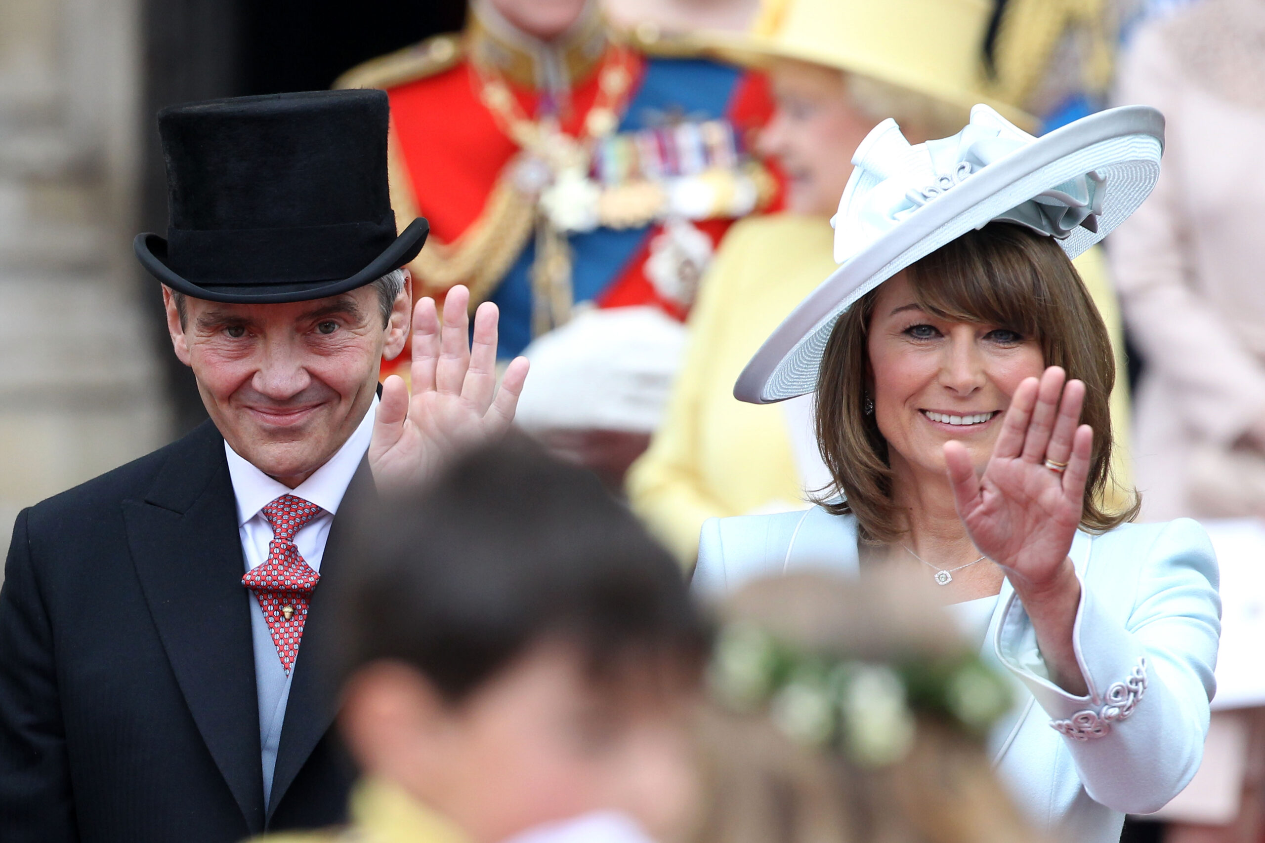 Michael and Carole Middleton smile and wave at the crowds following the marriage of Prince William, Duke of Cambridge and Catherine, Duchess of Cambridge at Westminster Abbey on April 29, 2011 in London, England.