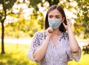 Woman wearing mask in park